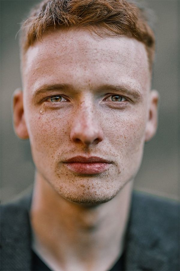 A close-up of a young man with freckles, crying. Photo by Rosie Hardy with a Canon RF 85mm F1.2L USM lens.