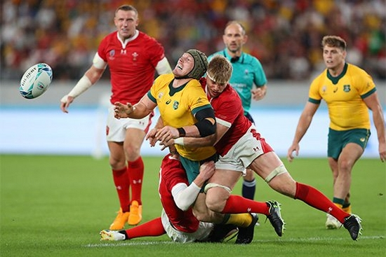 Two Wales players tackle an Australian player in the Walves v Australia match at Rugby World Cup 2019™. Taken by sports photographer Warren Little on a Canon EOS-1D X Mark II.