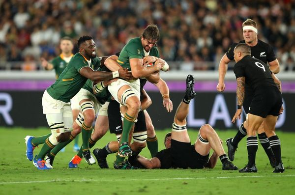 In the Rugby World Cup 2019™ Aouth Africa v New Zealand match, players grapple for possession of the ball. Taken by sports photographer Warren Little on a Canon EOS-1D X Mark II.