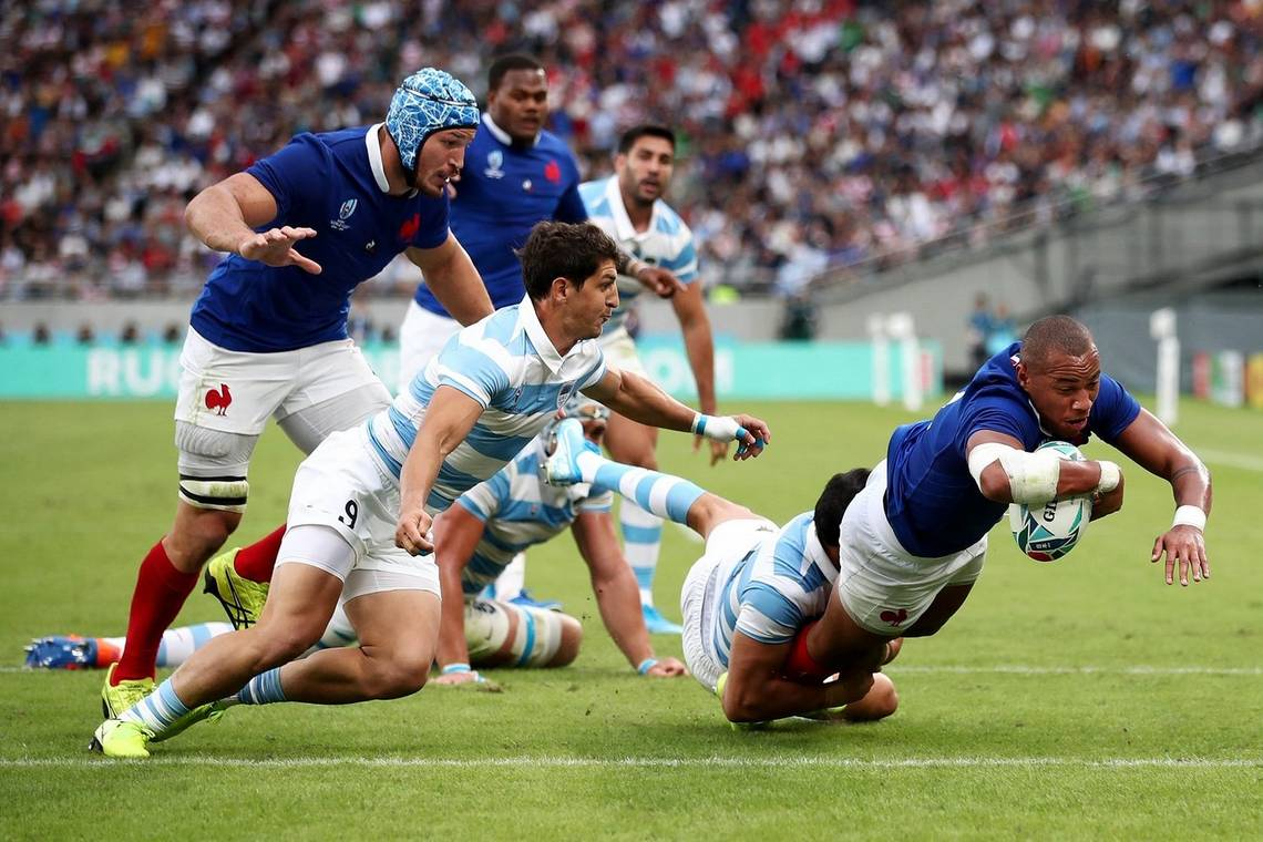 France rugby player Gaël Fickou dives to score a try against Argentina. Photograph by Cameron Spencer/Getty Images.