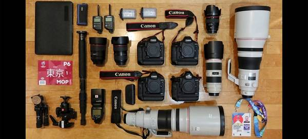 Cameron Spencer's photography kit laid out on a table.
