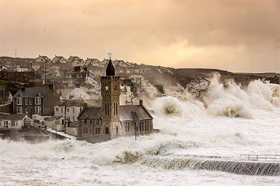 Waves crash over the sea wall during an early-morning storm at Porthleven in Cornwall. Photo by Carla Regler.