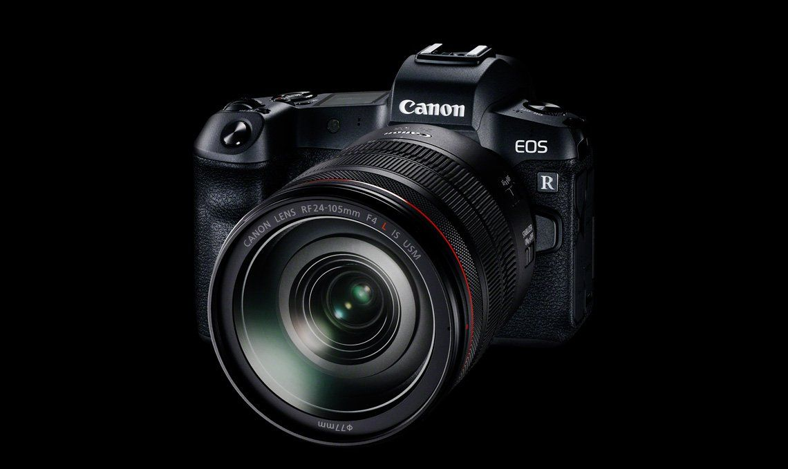 A Canon EOS R camera is pictured in front of a black background.