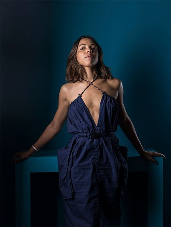 Actor Zita Hanrot photographed in a dark blue evening gown against a similarly coloured backdrop. Photograph by Paolo Verzone on a Canon EOS R.