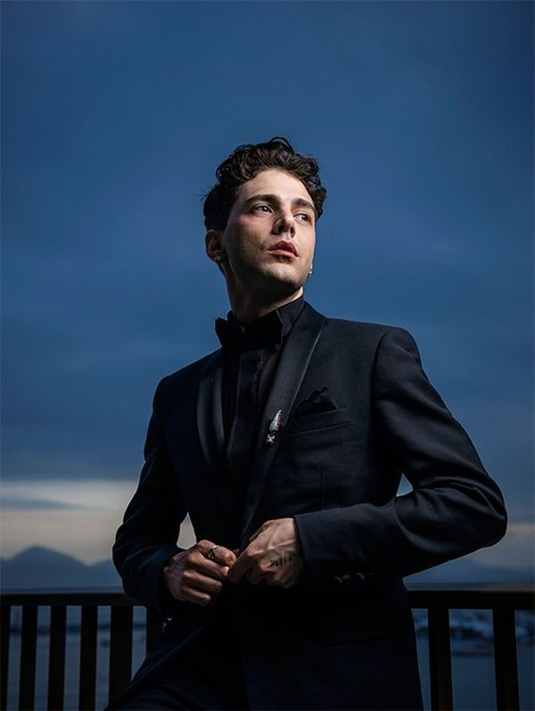 Director and actor Xavier Dolan on a balcony overlooking the Bay of Cannes in the evening light. Photograph by Paolo Verzone on a Canon EOS R.