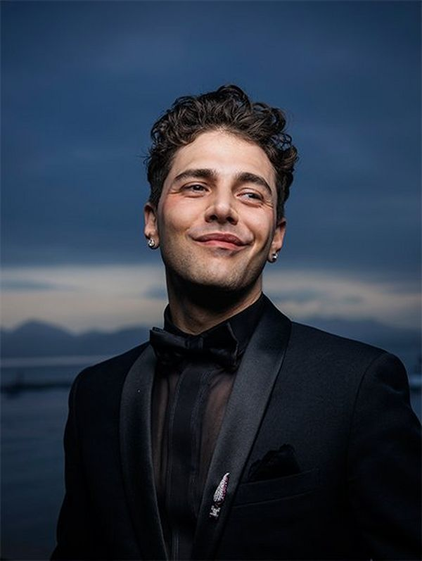 A head-and-shoulders image of Xavier Dolan with the Bay of Cannes in the evening light. Photograph by Paolo Verzone on a Canon EOS R.
