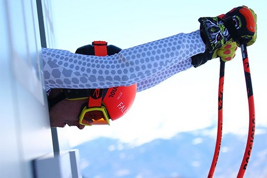 A close-up of a skier preparing to launch himself down a slope