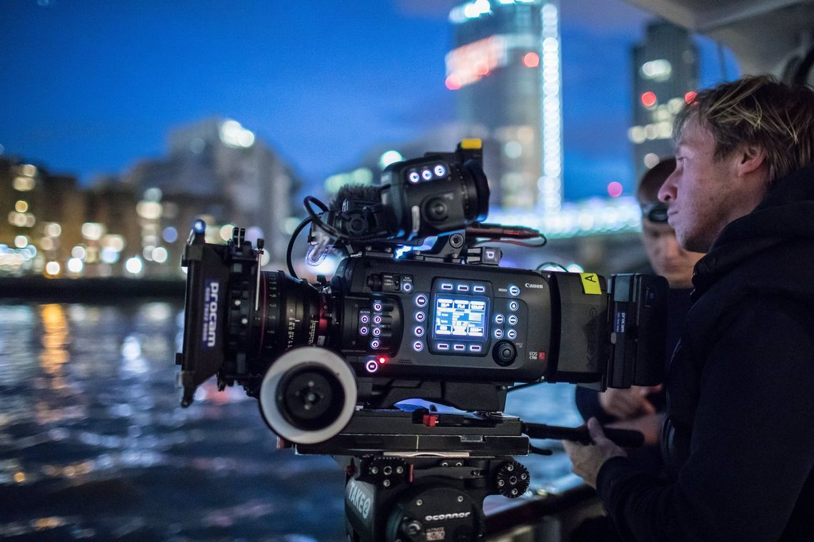 Cinematographer Steve Lawes and First AC Ben Margitich film a luxury river yacht at night on the Thames in central London with the Canon EOS C700.