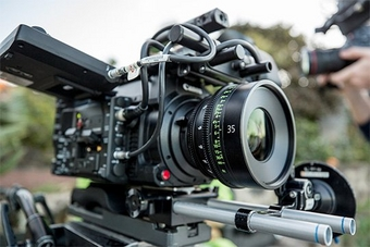 A Canon Sumire Prime cine lens in use on a cine camera on location.