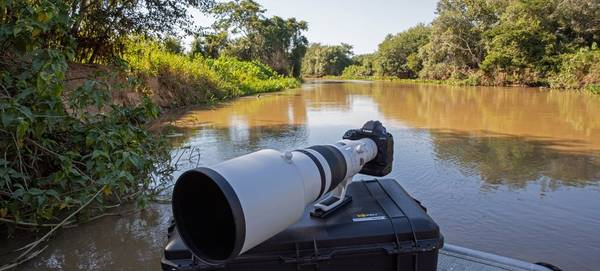 A Canon EOS-1D X Mark III with telephoto lens rests on a camera case in Brazil's Pantanal wetlands.