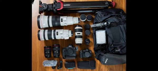 Thorsten Milse's kitbag, containing Canon camera bodies including an EOS R, plus a range of Canon lenses and accessories.