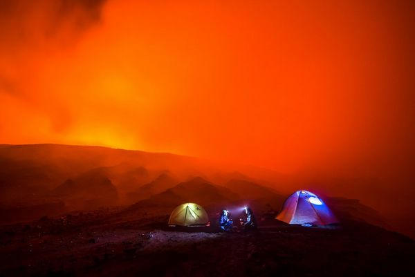 Three tents erected on the side of an active volcano.