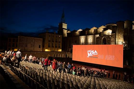 The stands filling with viewers at the outdoor night-time screening at Visa pour l'Image 2018.