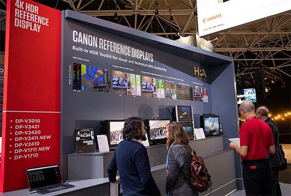 People looking at 4K HDR Canon displays at IBC.