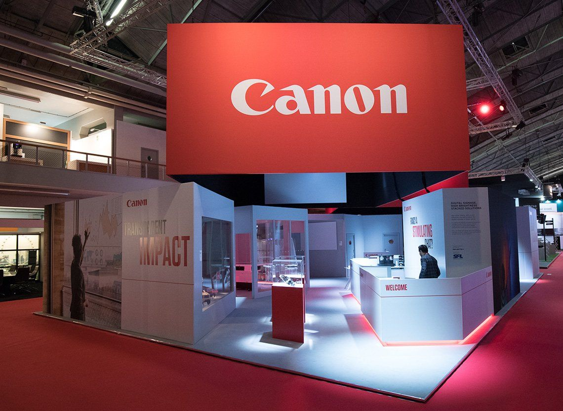 The Canon stand at the ISE trade show, with inspiring photography on displays, projectors and Canon products ready to try, and an expert standing by.