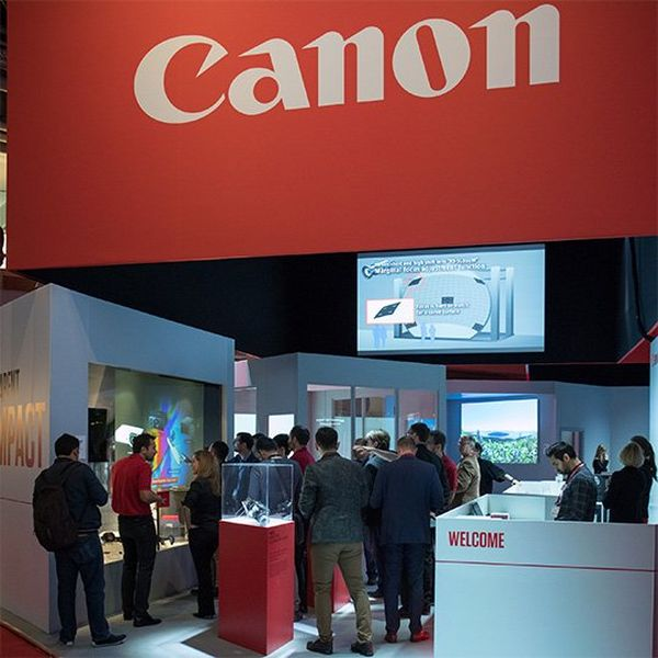 The Canon stand at the ISE trade show, full of visitors looking at imaging products.