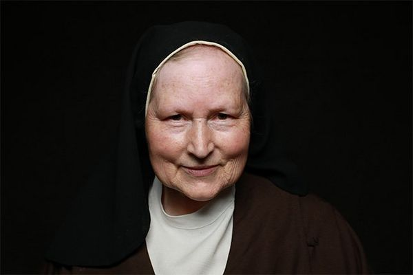An Irish nun wears a traditional black habit.