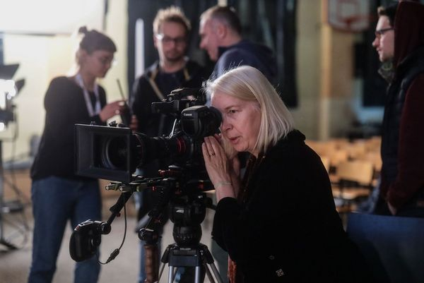 Cinematographer Claudia Raschke operating a video camera.