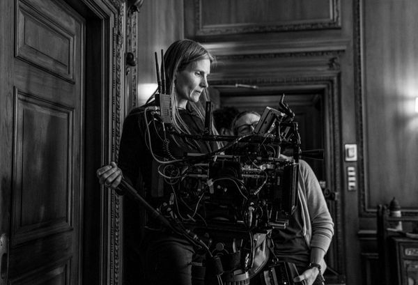 Cinematographer Laela Kilbourn operating a cine camera.