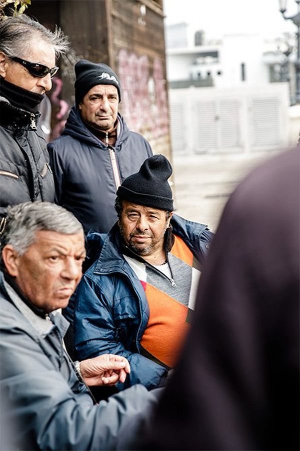 Italian men in a travel street scene. Photo by Annapurna Mellor with a Canon EF 24-70mm f/2.8L II USM.