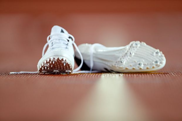 running shoes left on track
