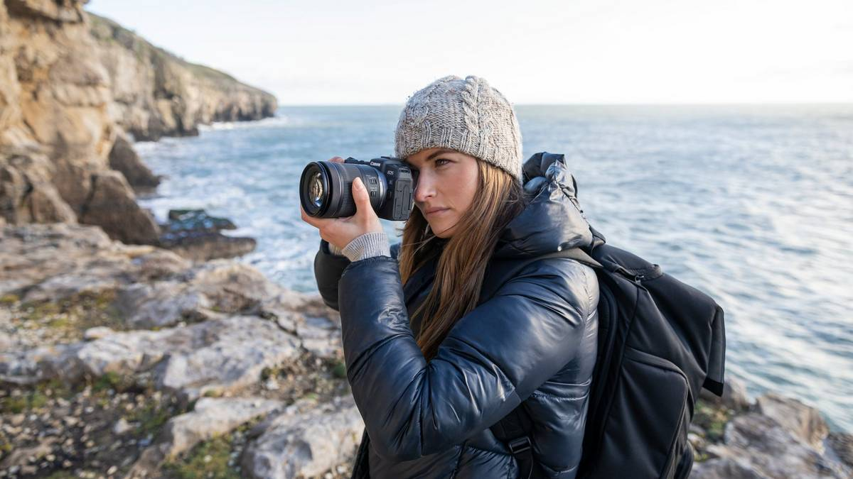 Lady wearing a grey beanie and blue coat while shooting on the EOS RP with RF 24-105mm F4-7.1 IS STM