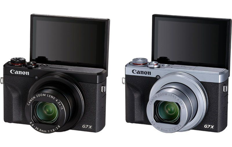 Two Canon G7X Mark 3's Side By Side. The Black One and The Black and Silver One.