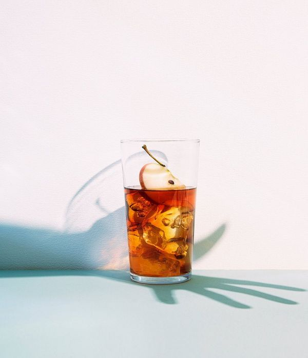 A glass of cider and ice forms a still life shot, accessorised with the artist's shadow as Felicity McCabe overlays the shape of her hand over the drink.