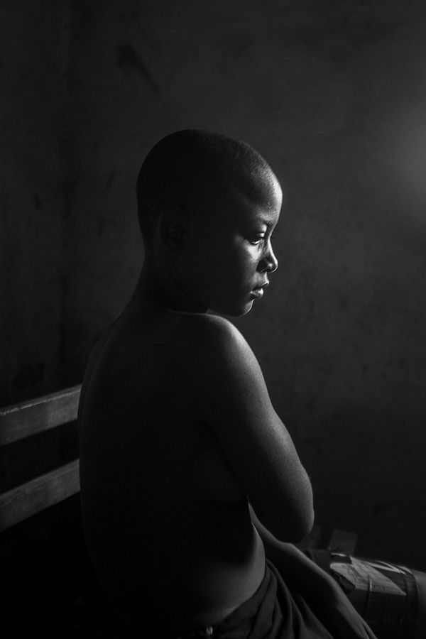 Kamini Tontines, a 12-year-old in Cameroon, is hiding her breasts after having them ironed by her mother.