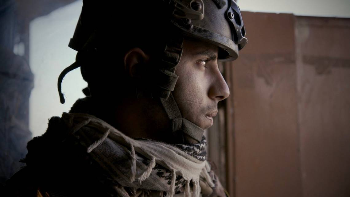 A side-on portrait of an Iraqi Special Operations Forces soldier wearing a helmet. Captured with a Canon EOS C300 Mark II in Mosul, 2016. © Olivier Sarbil
