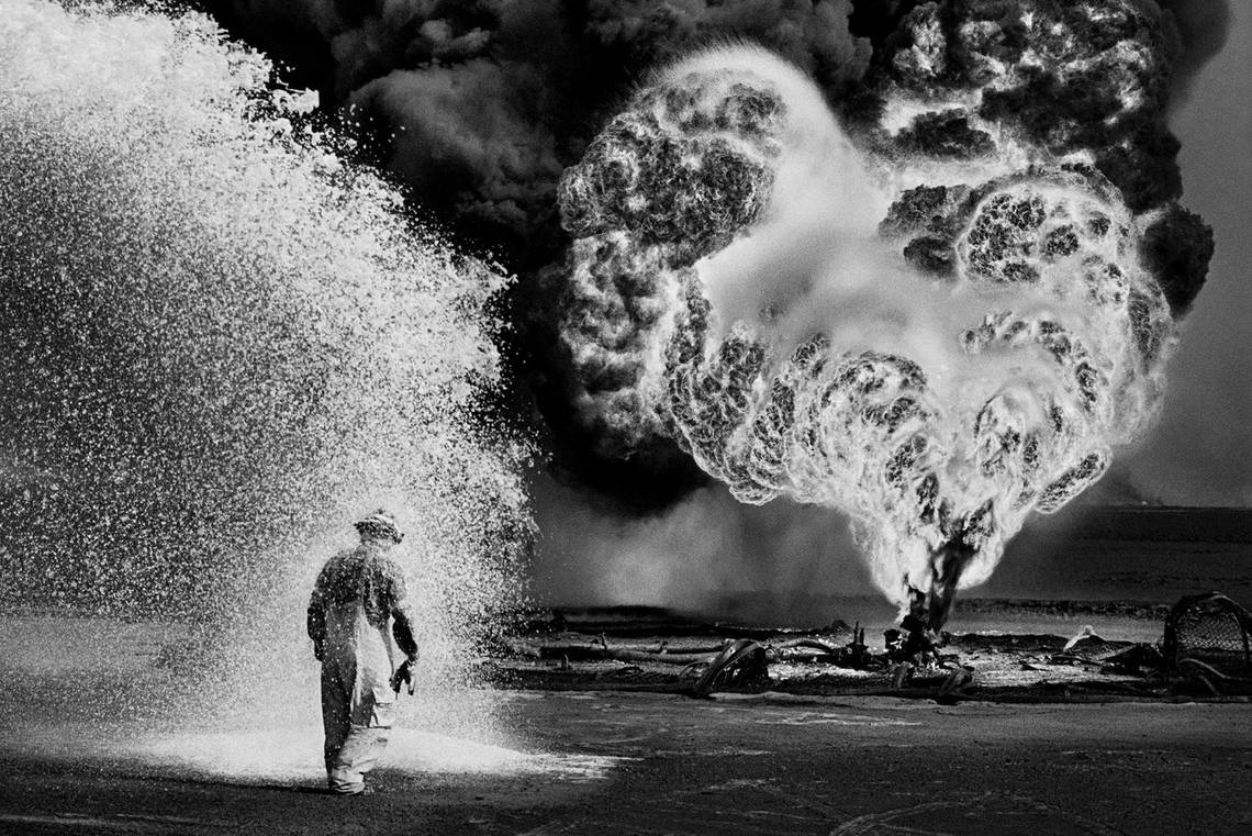 Sebastião Salgado's black-and-white picture of firefighters tackling the Kuwait oil fires in 1991.