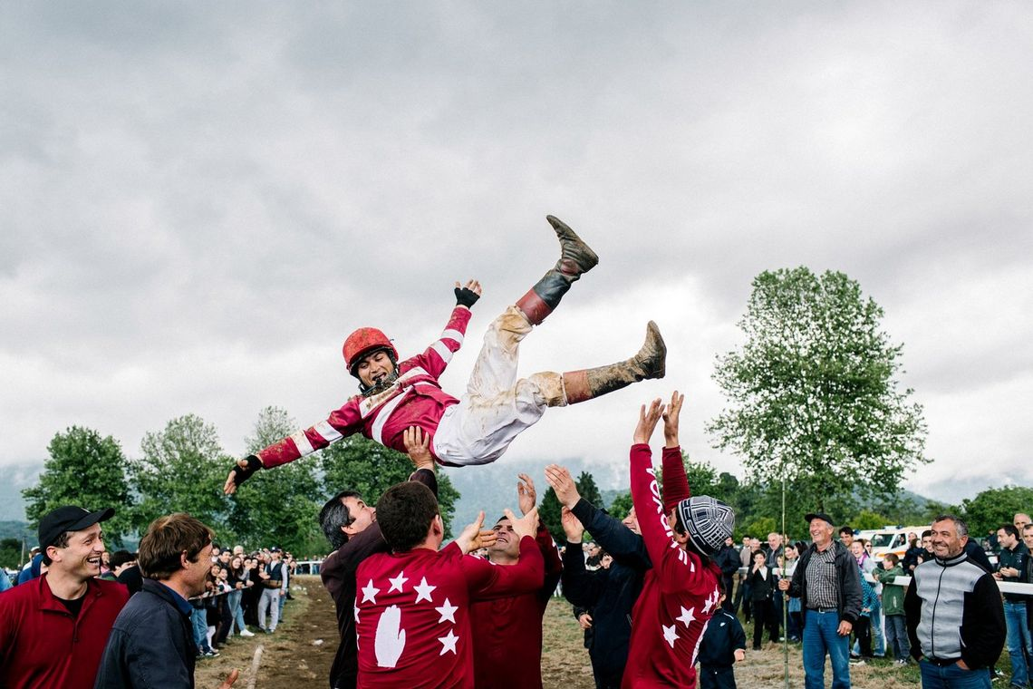 Etluhov Islam celebrates his victory in the horse racing. Important national sports such as this take place twice a year in Abkhazia, on 9 May and 30 September.