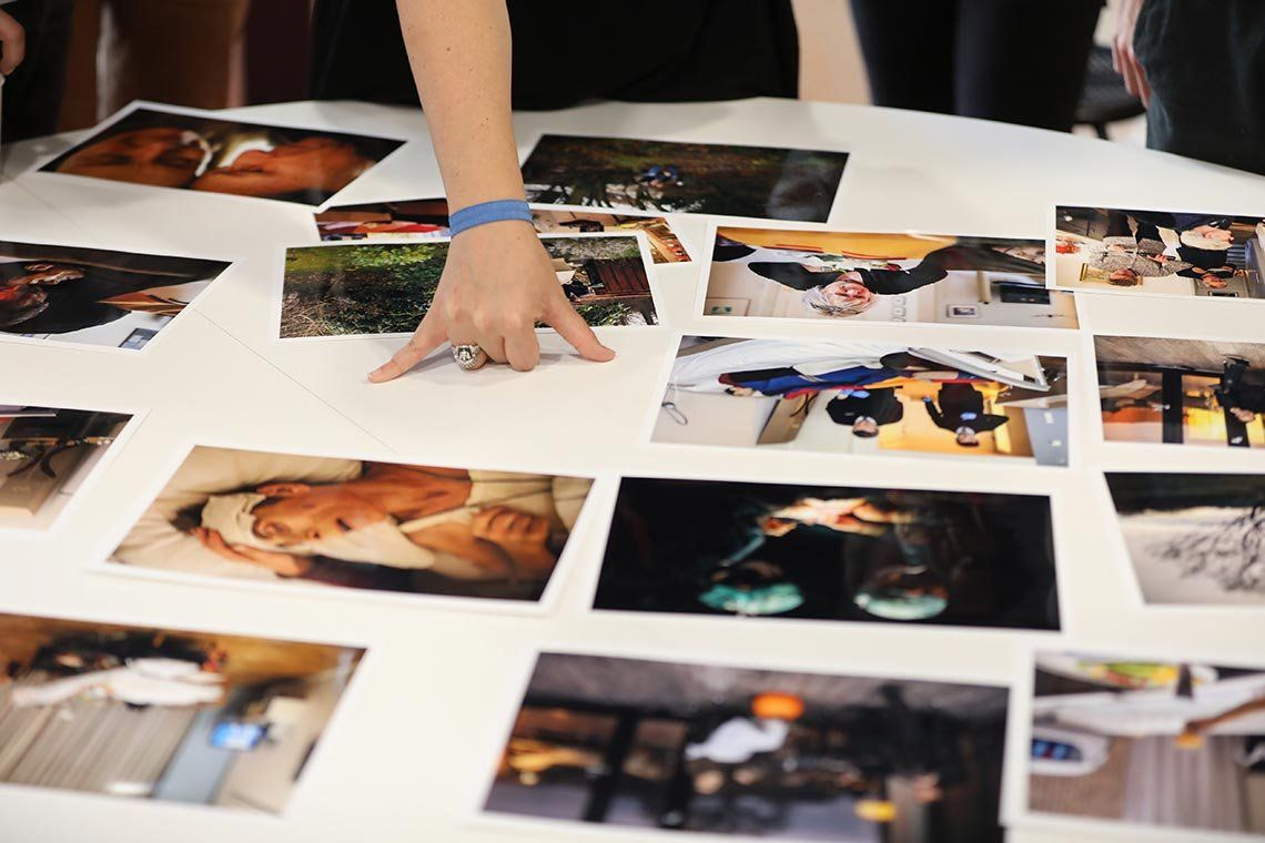 A young photographer presents a selection of colour prints at a portfolio review run by Canon and Magnum Photos at the Visa pour l'Image photojournalism festival in Perpignan, France.