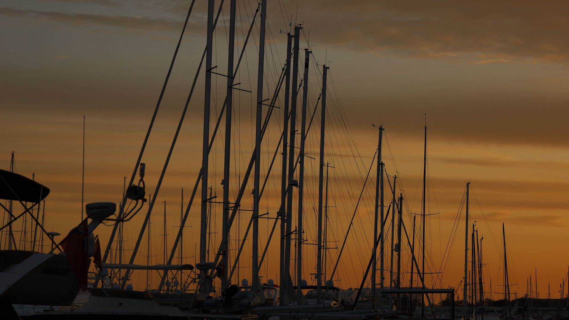Shot on RF 24-105mm F4-7.1 IS STM of sailing boat masts at sunset