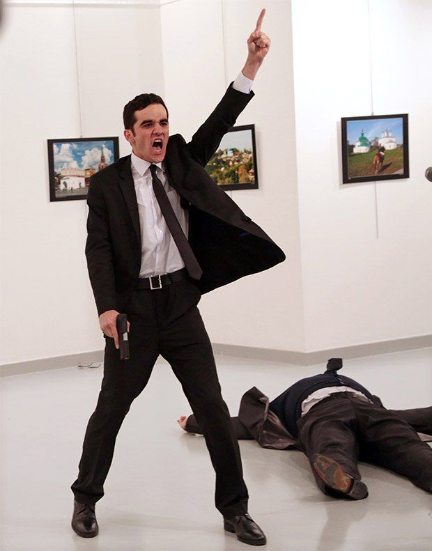 Burhan Ozbilici captures police officer Mevlüt Mert Altıntaş shouting after shooting Andrey Karlov, the Russian ambassador to Turkey.