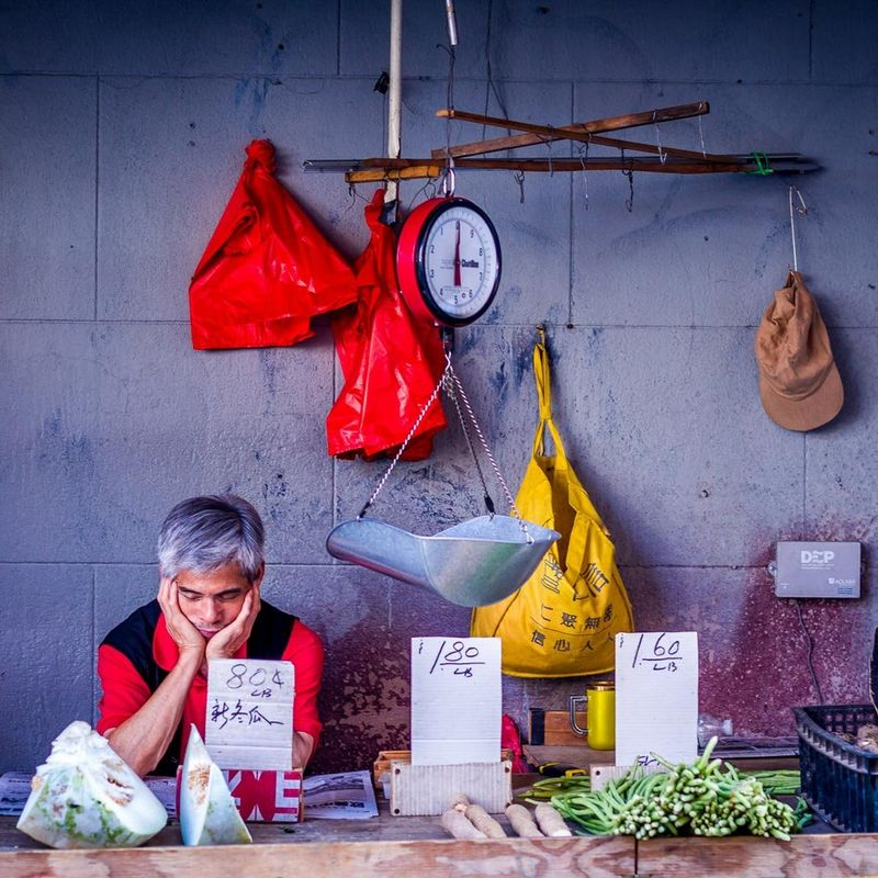 man at market stall in Chinatown