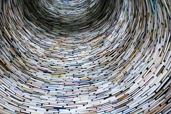 books stacked in the shape of a tunnel