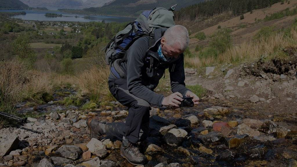 Alan Rowan using the Canon PowerShot SX740 HS to photograph a stream