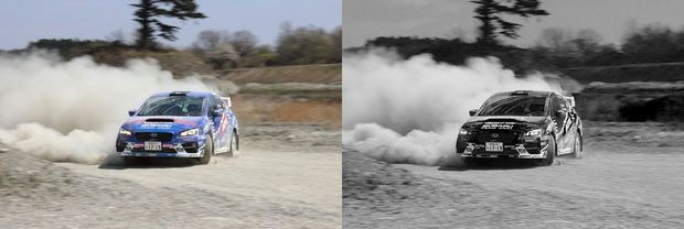 racecar blows up dust on track in black & white