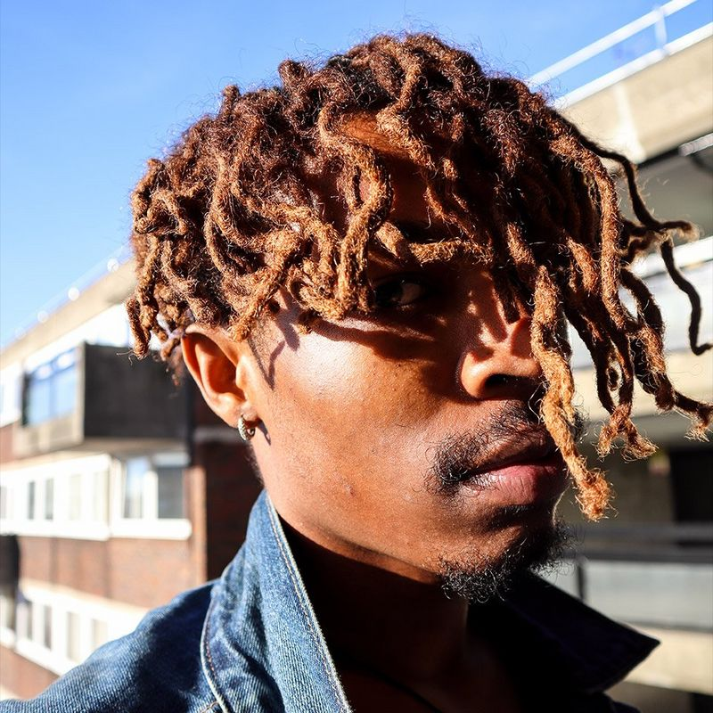 Close up of man with dreadlocks shot on the Canon EOS M50
