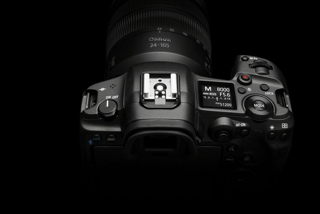 The Canon EOS R5, showing the mode button and LCD panel on top, to the right of the viewfinder.