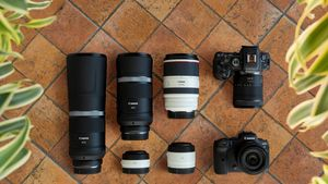 Two Canon EOS R6 cameras and Canon lenses laid out on a tiled floor.