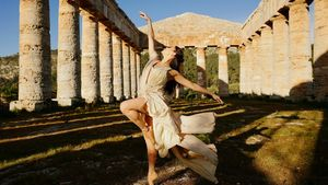A ballerina dances inside a ruined temple near Palermo, Sicily.