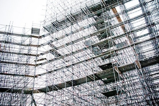 Scaffolding against a grey sky