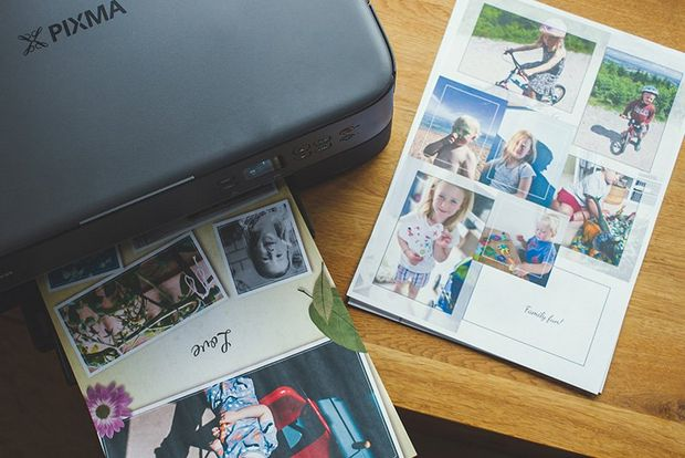 A Canon PIXMA TS5340 printer on a tabletop printing out photo collages.