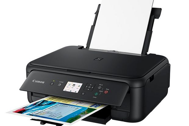 A Canon PIXMA TS5150 Series printer with its paper tray extended.