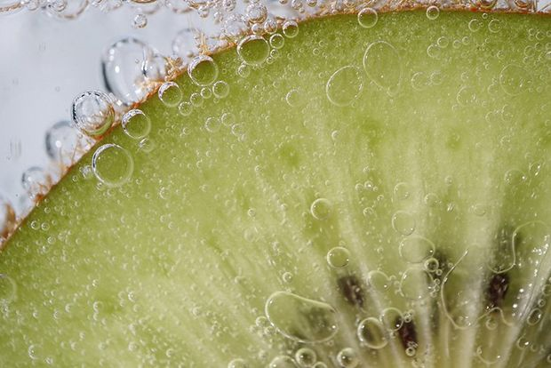 A close-up of a slice of kiwi fruit.