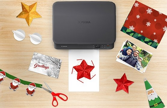 PIXMA printer on a table surrounded by festive season ideas