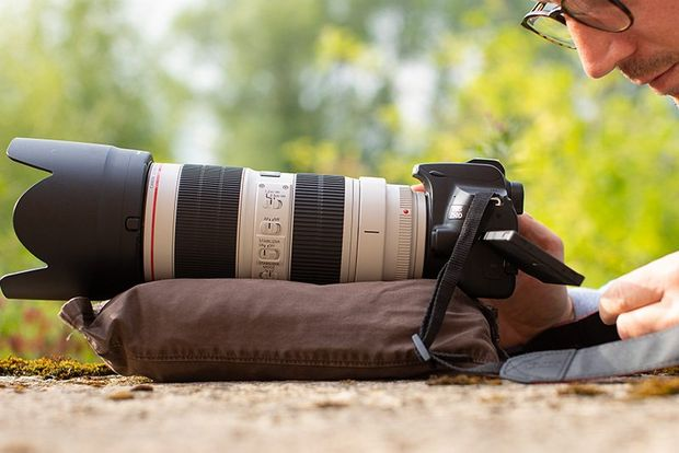 A Canon EOS 250D with a Canon EF 70-200mm f/2.8L IS III USM lens rests on a homemade beanbag.