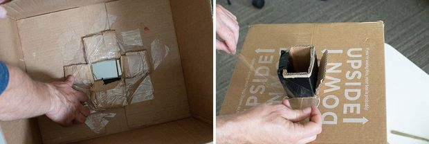 The inside of a large cardboard box with the flaps of the cardboard sheath secured inside.